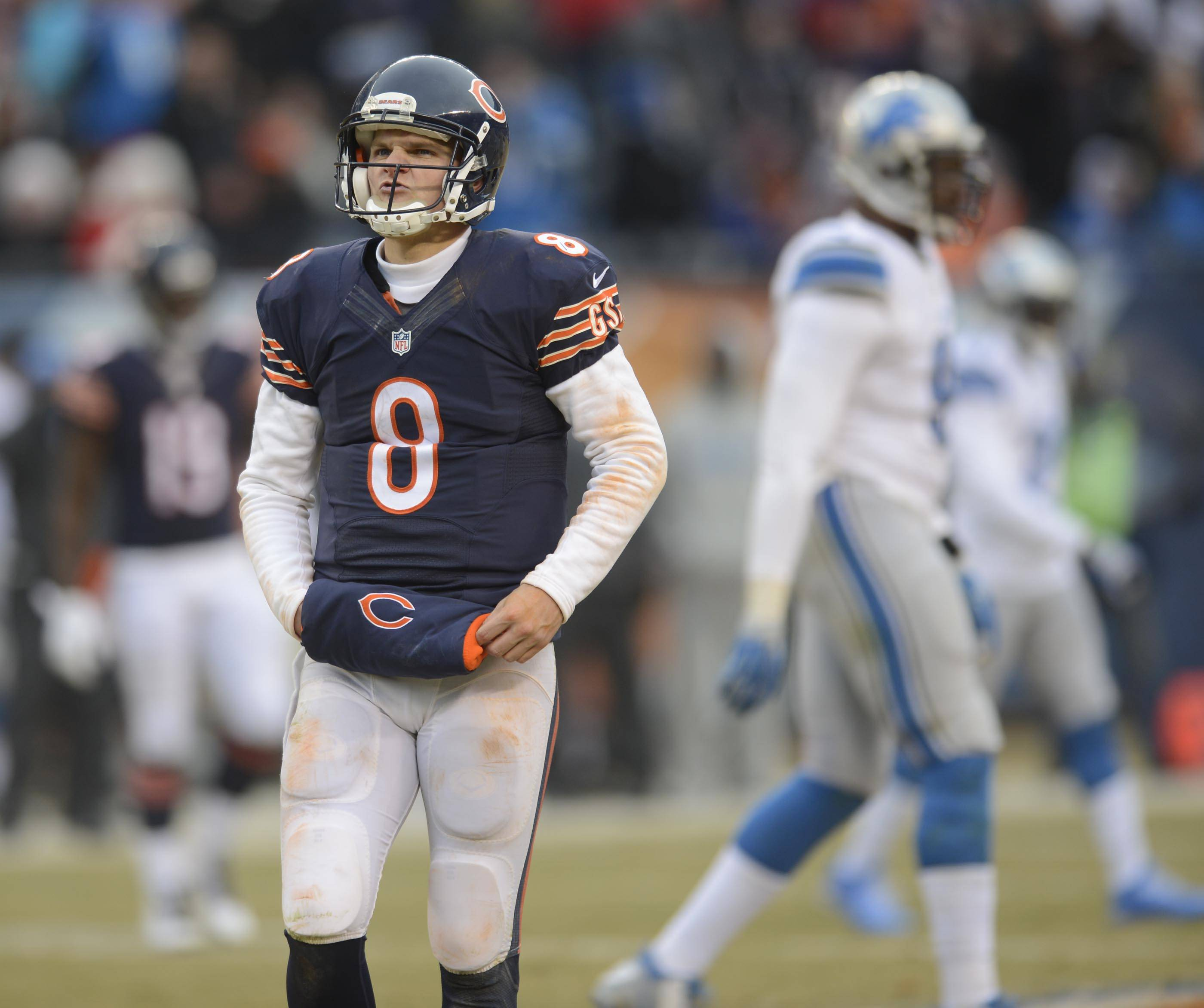 Chicago Bears quarterback Jimmy Clausen reacts after throwing an incomplete pass on third down in their last possession against the Detroit Lions Sunday at Soldier Field in Chicago.
