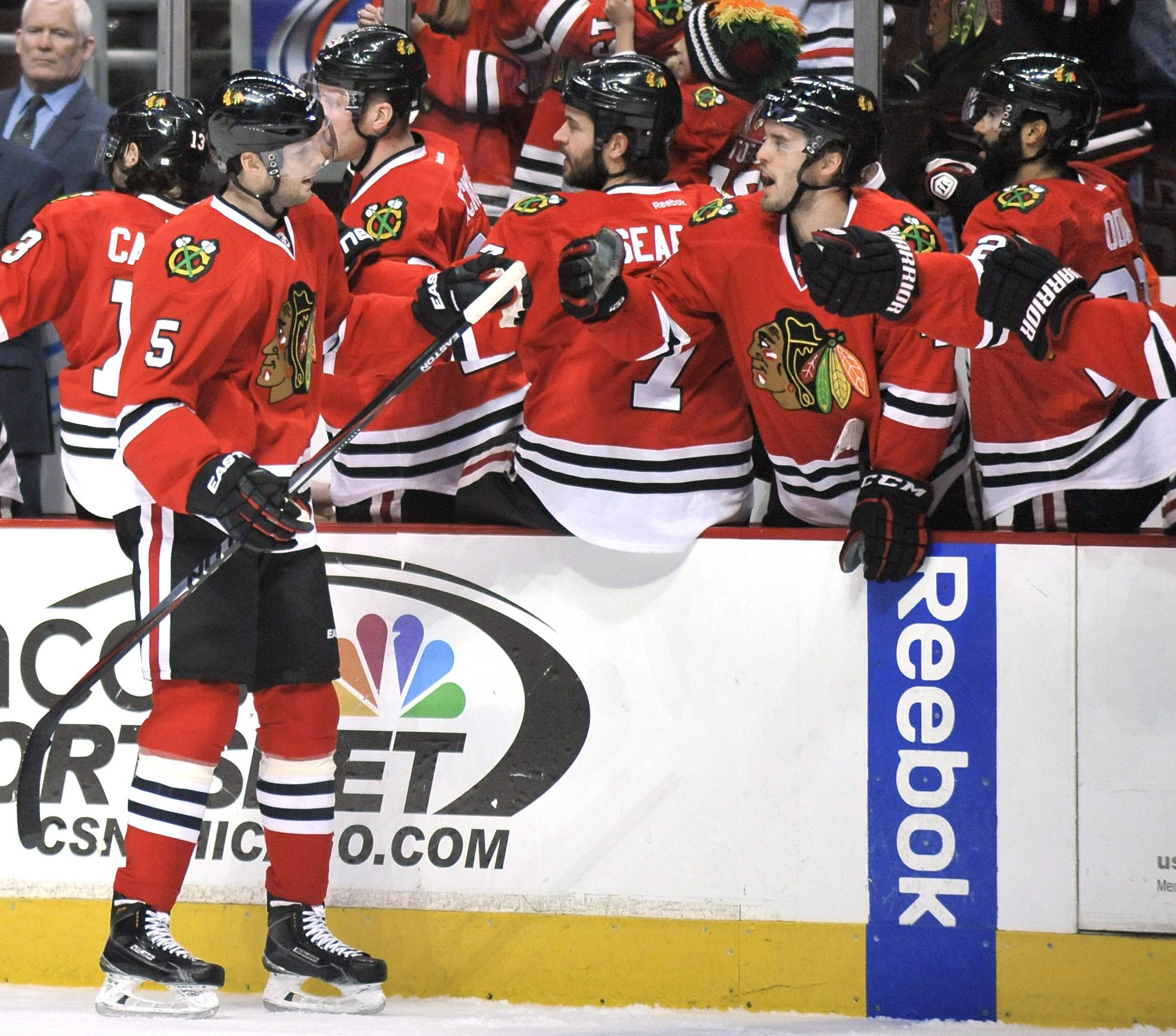 The Blackhawks' David Rundblad celebrates with teammates Sunday on the bench during the first period of an NHL hockey game against the Toronto Maple Leafs in Chicago.