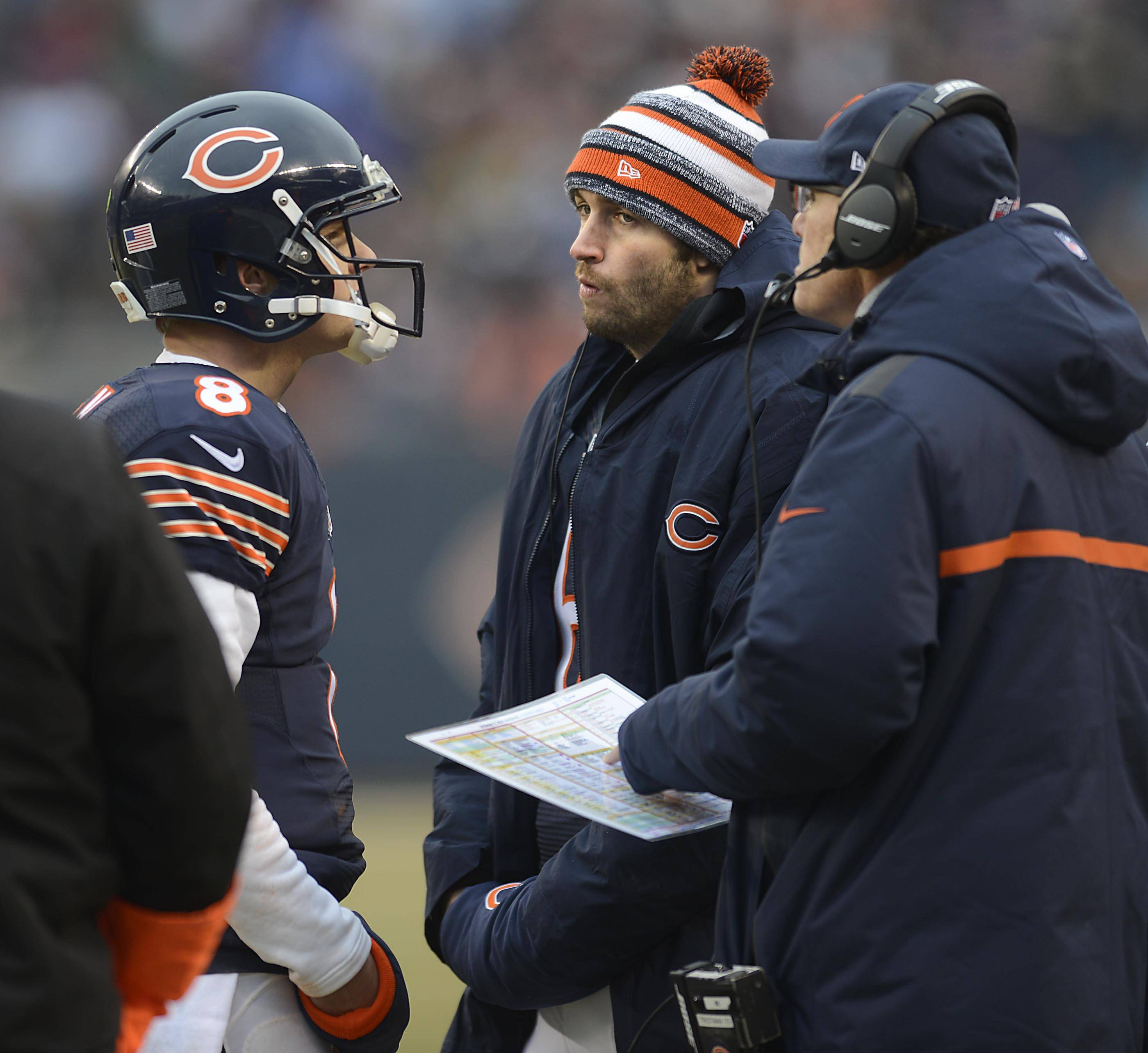 Bears quarterback Jay Cutler reacts as he listens to a conversation between Jimmy Clausen and coach Marc Trestman late in the first half Sunday at Soldier Field in Chicago.