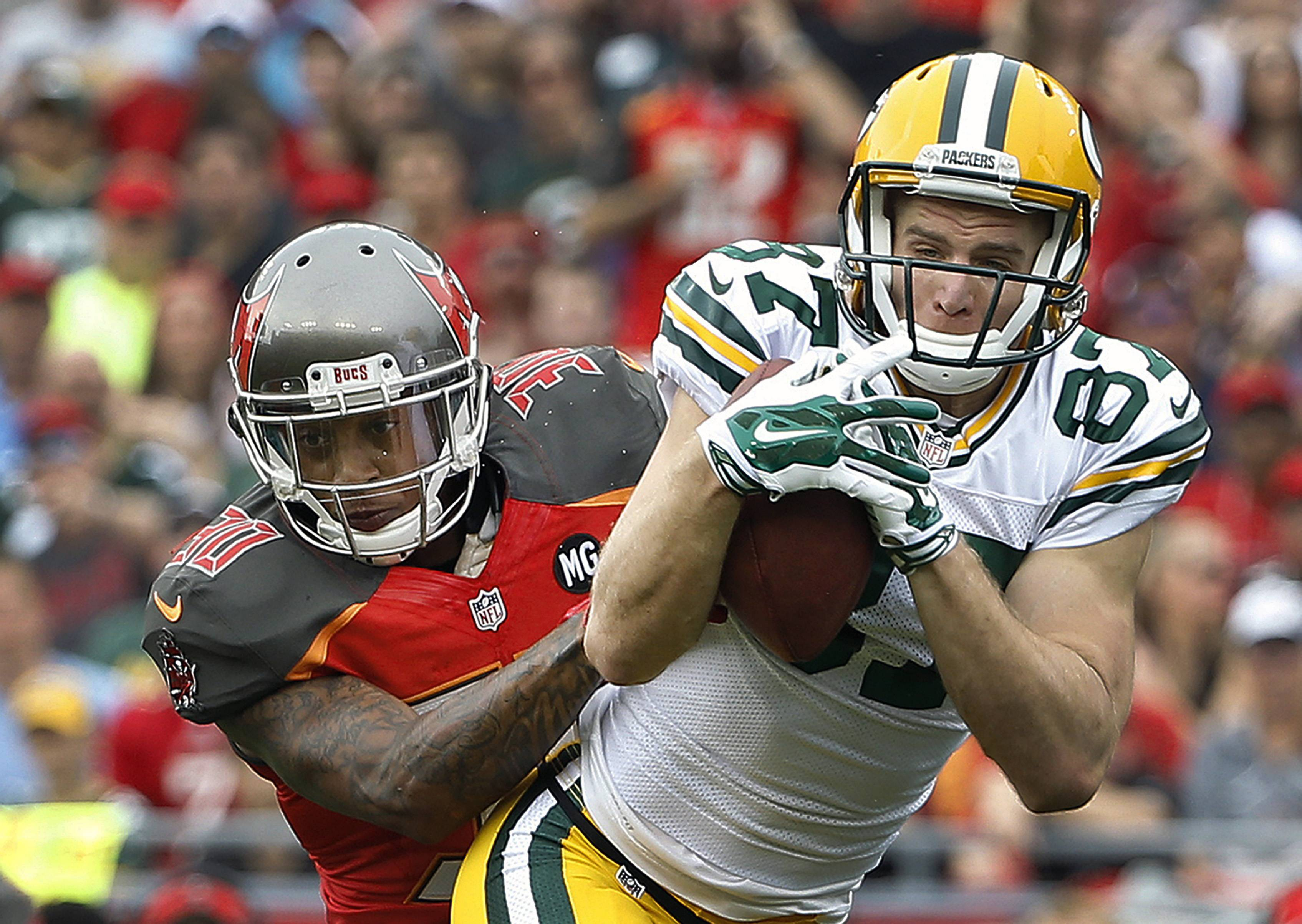 Green Bay Packers wide receiver Jordy Nelson makes a catch in front of Tampa Bay Buccaneers strong safety Bradley McDougald during the first quarter Sunday in Tampa, Fla.