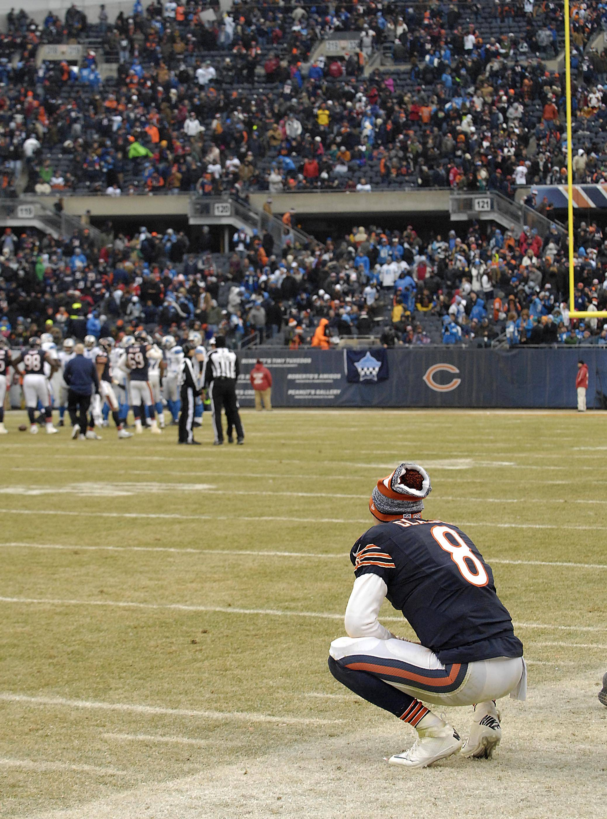 Bears quarterback Jimmy Clausen squats on the sidelines Sunday after the Bears' last possession in the loss to the Detroit Lions at Soldier Field.