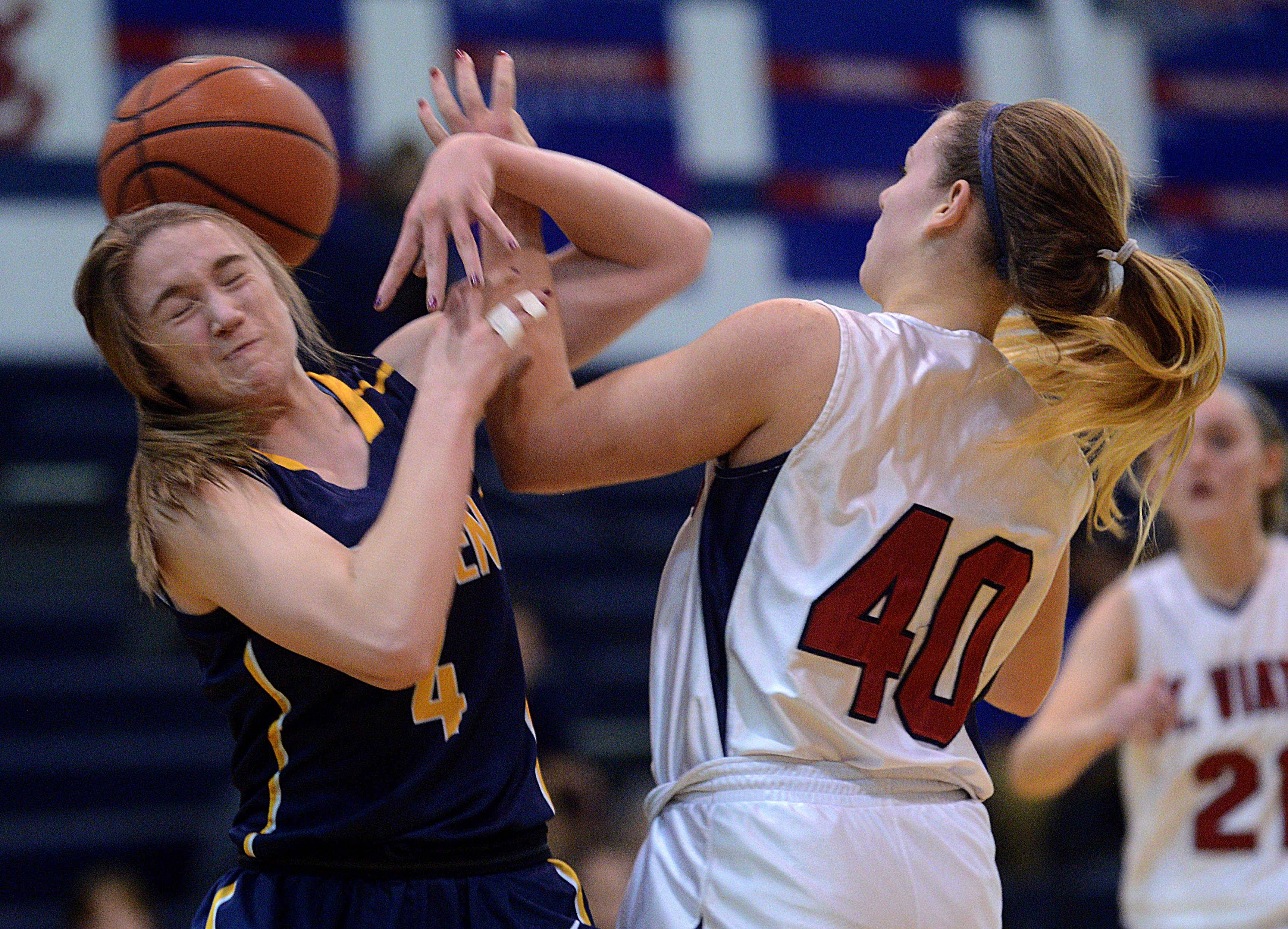 St. Viator's Kayne Stanley, right, battles Leyden's Autumn McGee for the ball during the 32nd Annual Snowflake Varsity Girls Basketball Tournament Monday night in Arlington Heights.