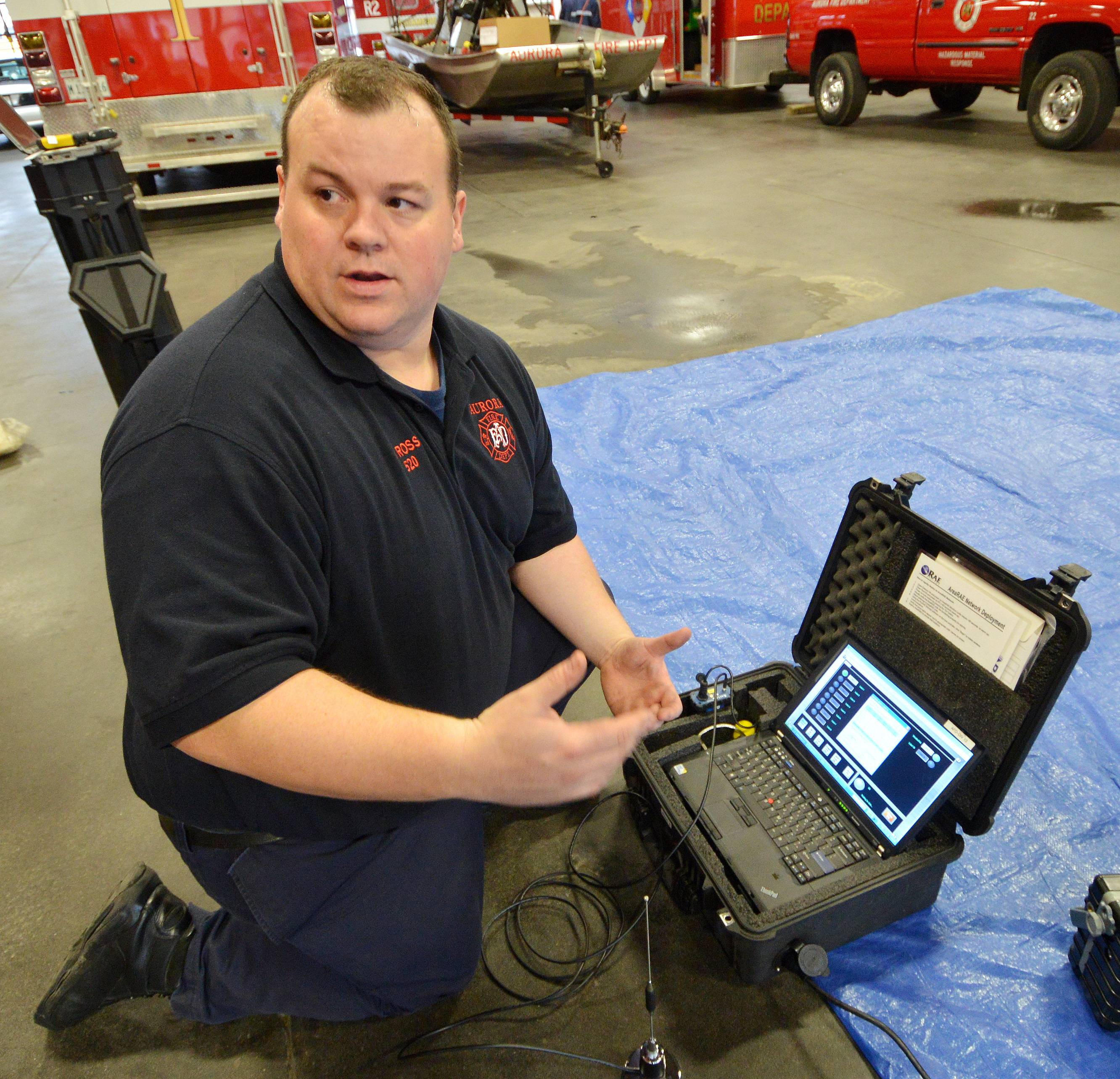 Aurora firefighter/paramedic John Ross is a hazmat specialist who is one of 21 members of the force who are trained to monitor hazardous material situations. The monitors send information back to this portable computer, which displays data including maps of how clouds of poisonous gasses are dispersing for potential evacuation situations.