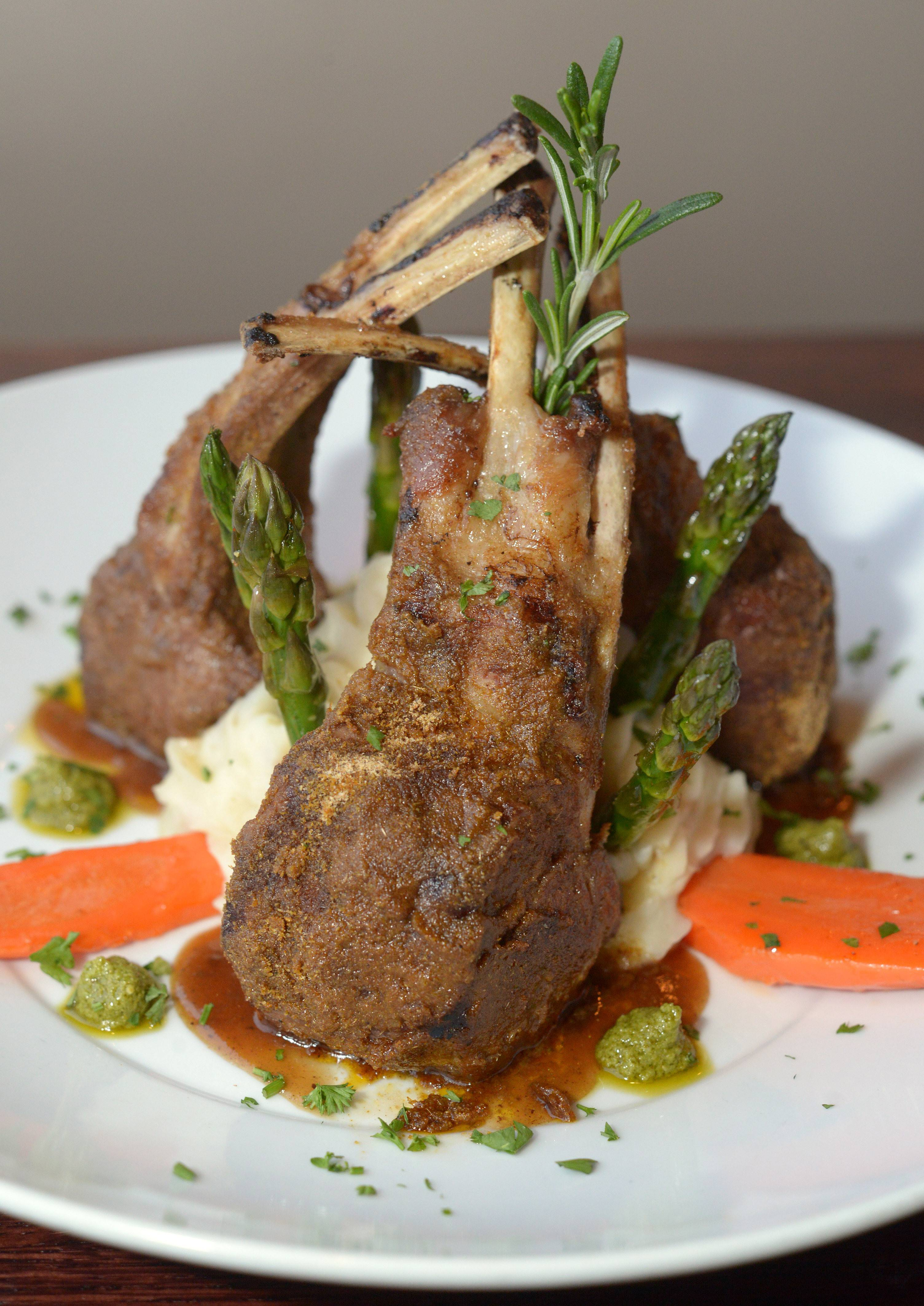 Cumin and garlic crusted Australian lamb chops served with garlic mashed potatoes, roasted carrots and asparagus at Top Table in St. Charles