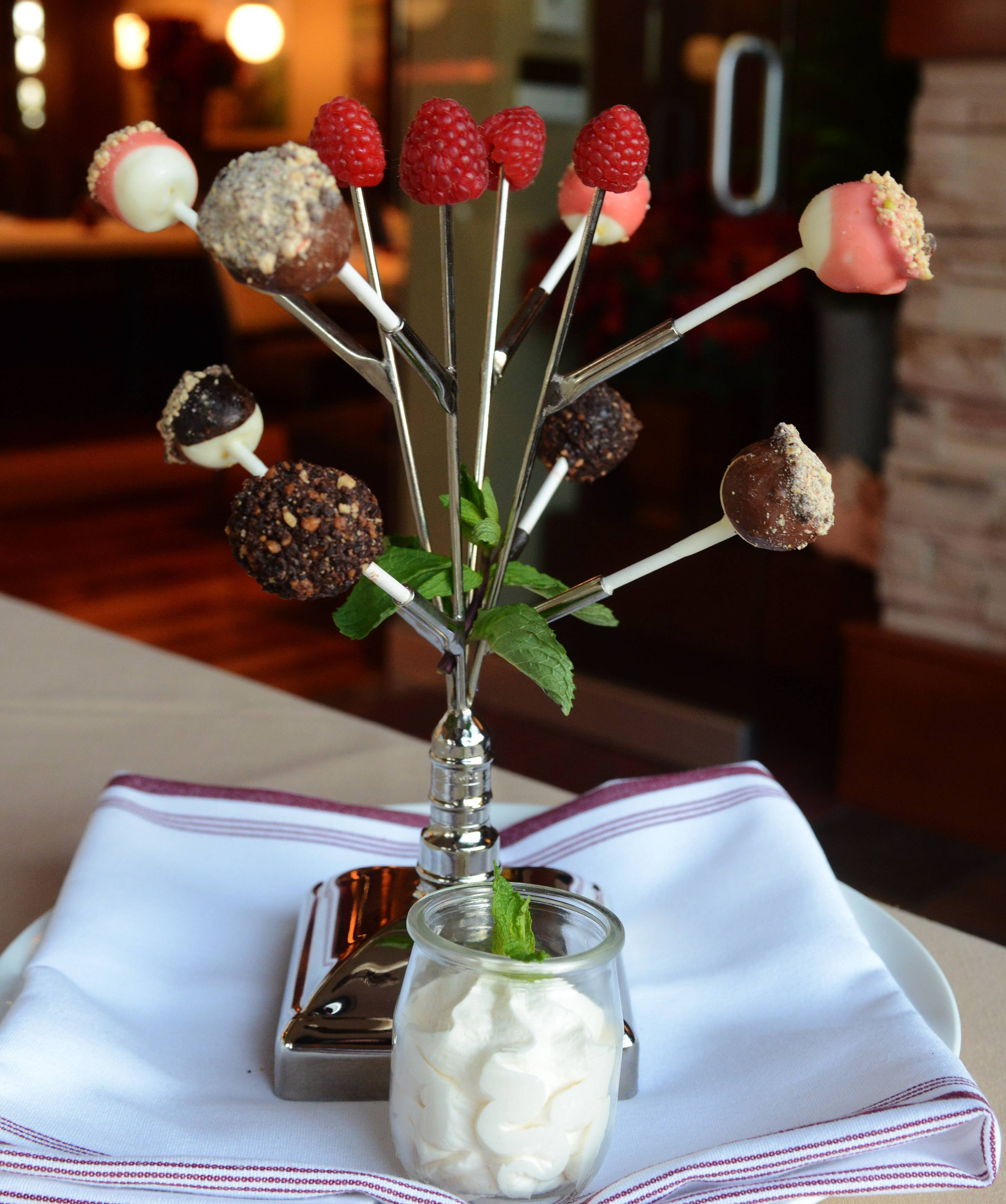 Cake pops come with bubble gum whipped cream at Grillhouse by David Burke in Schaumburg.