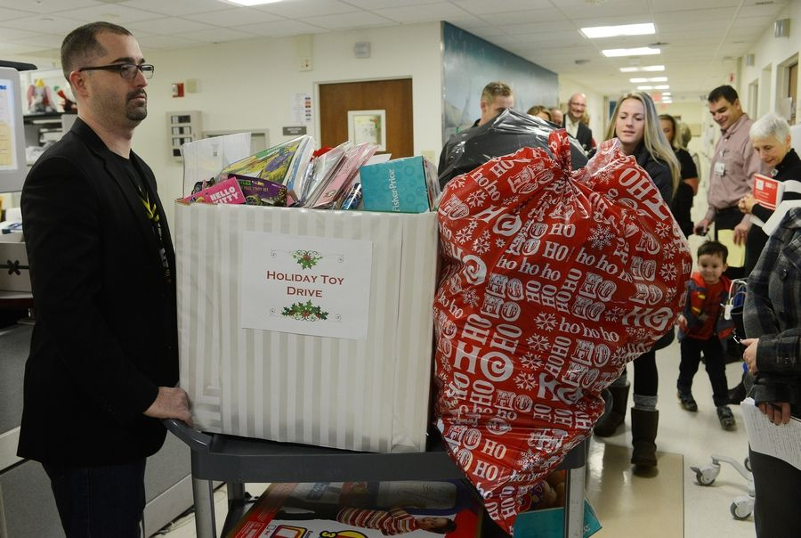 Tim Brigham pushes a cart loaded with gifts.