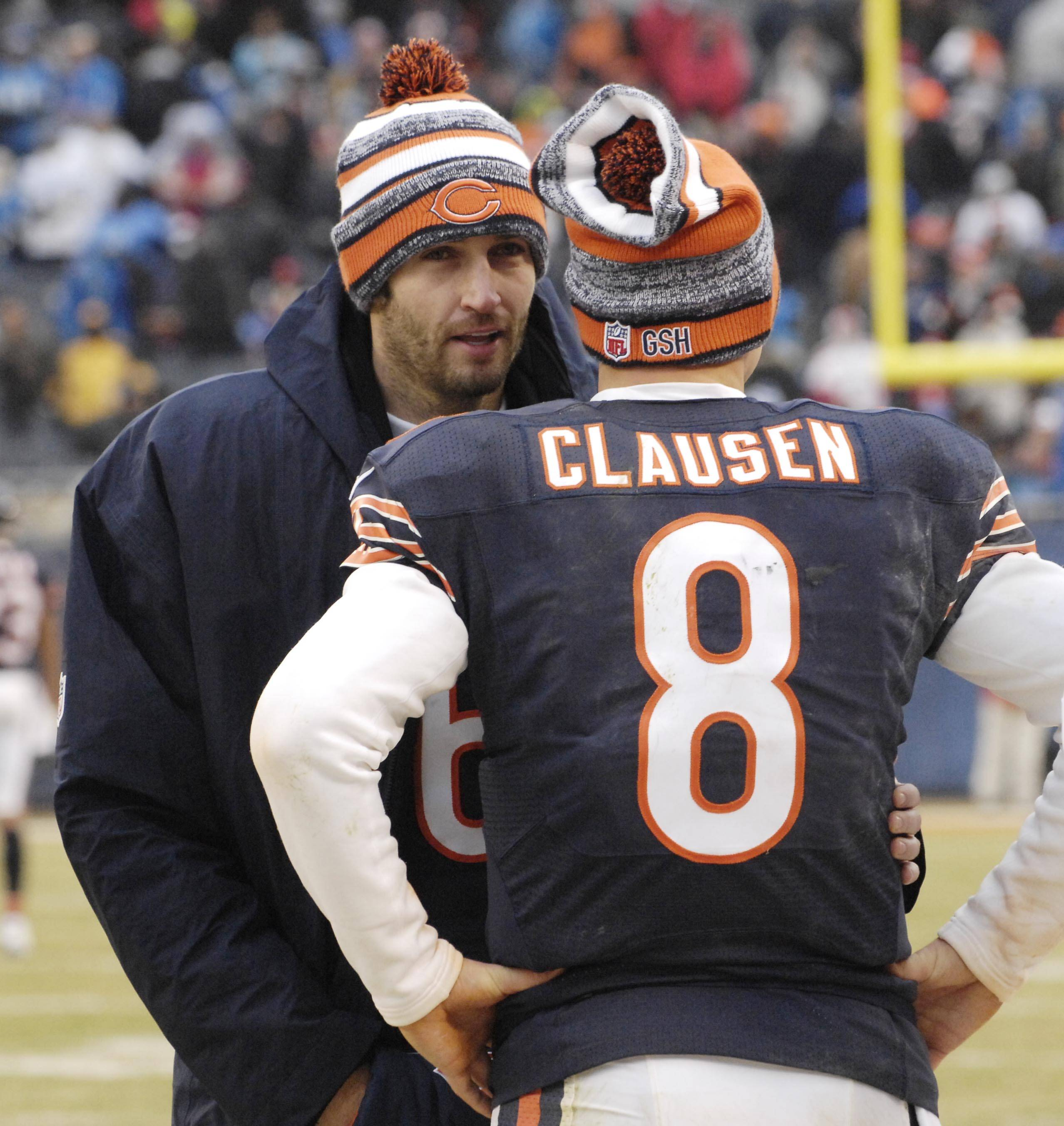 Bears quarterback Jay Cutler, back in the starter's role for the season finale at Minnesota, talks to Jimmy Clausen near the end of Sunday's loss to the Lions at Soldier Field.