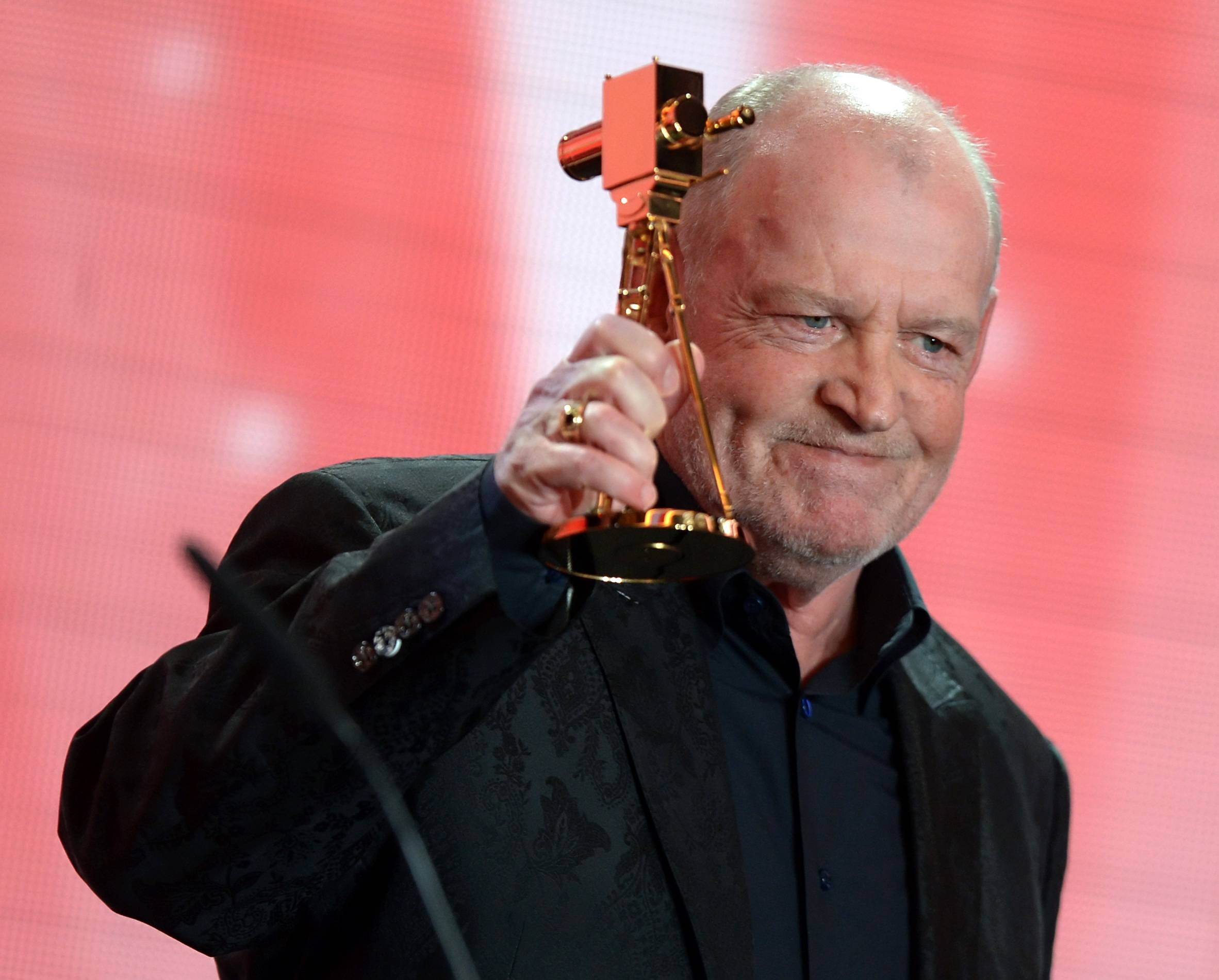 British singer Joe Cocker speaks after receiving the lifetime achievement award for music during the 48th Golden Camera award ceremony in Berlin, Germany.