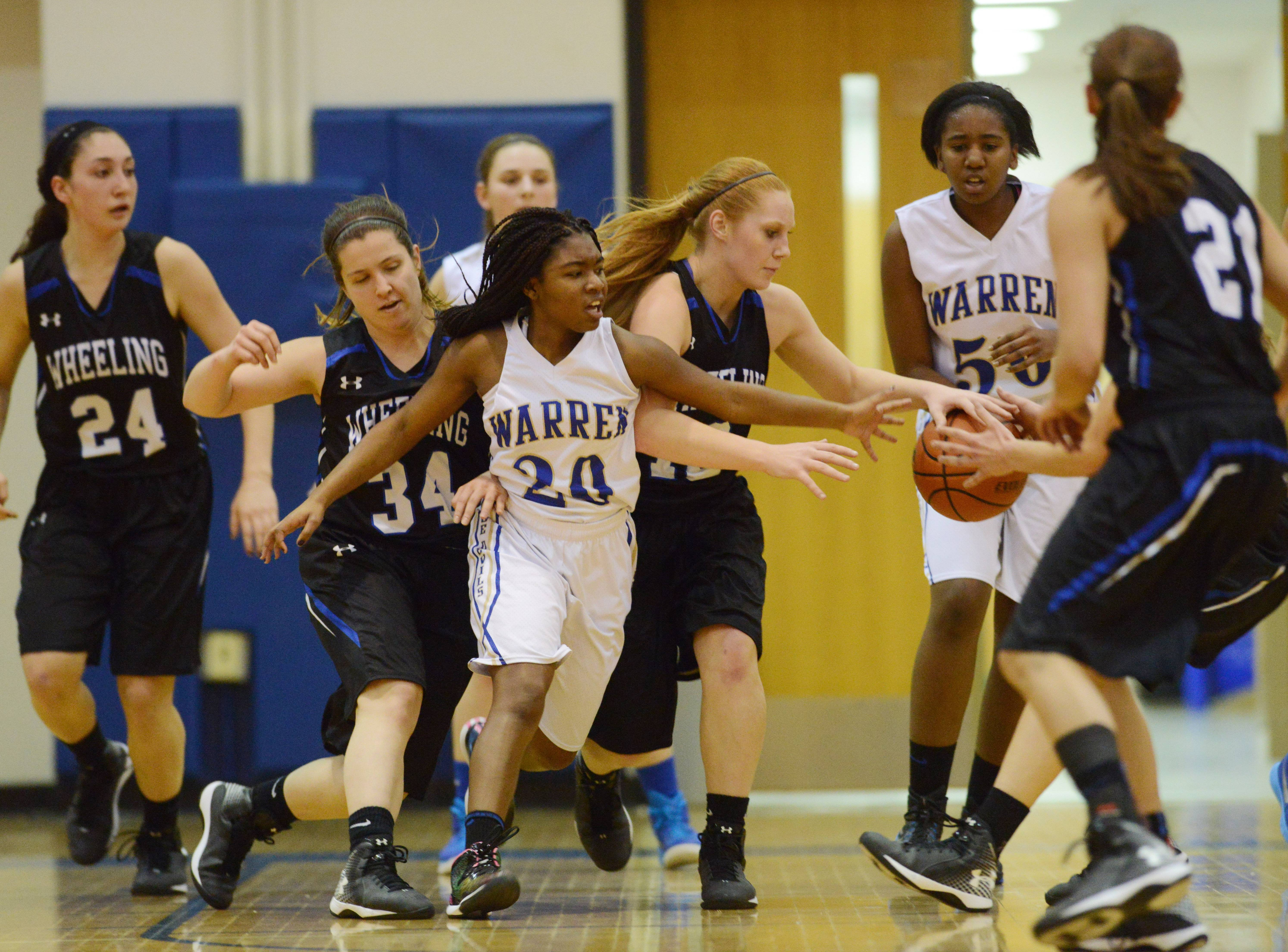 Images from the Wheeling vs. Warren girls basketball game on Saturday, Dec. 27 in Gurnee.