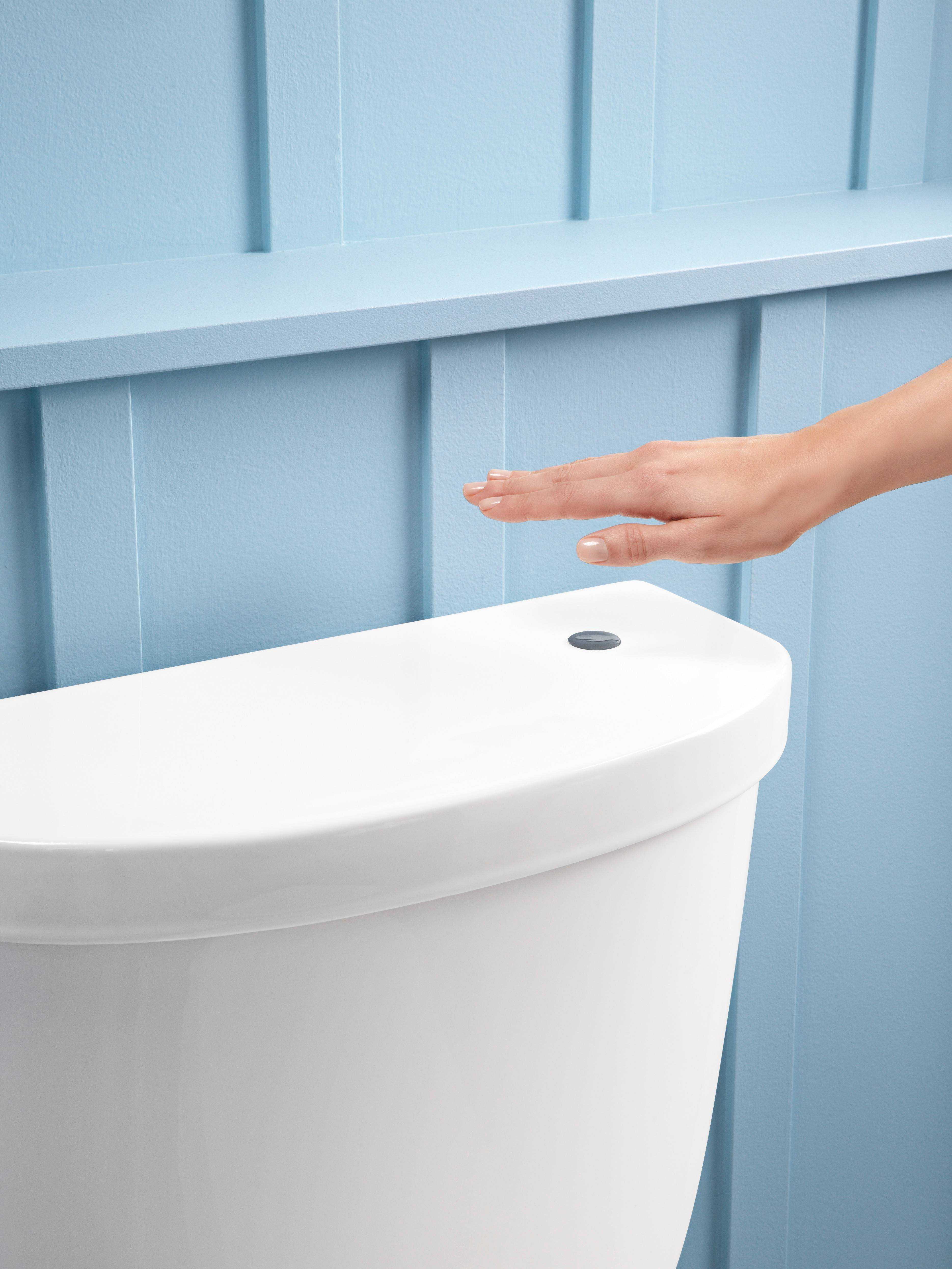 A simple gesture initiates a hands-free flush with this Kohler touchless toilet.