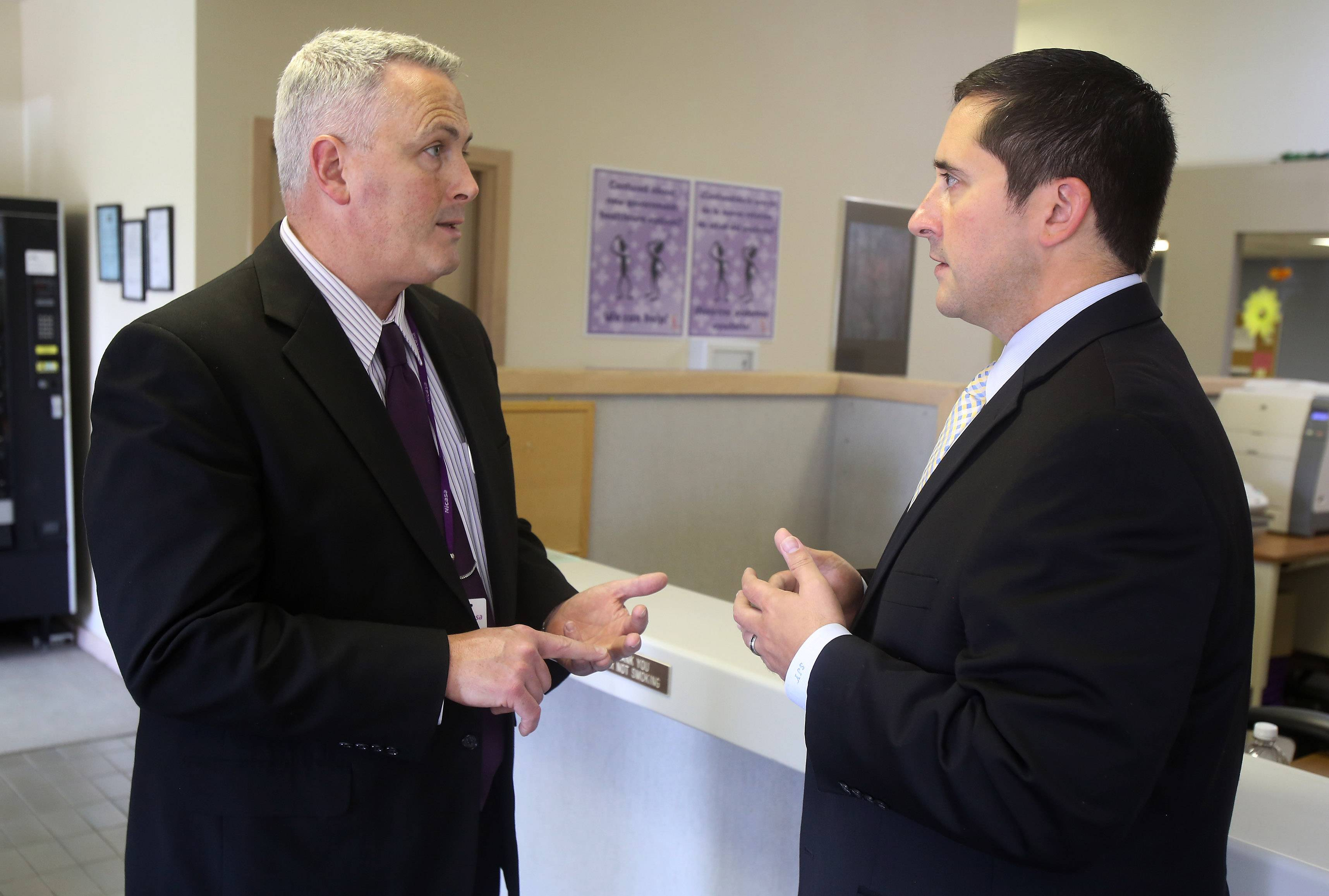 Bruce Johnson, CEO of Nicasa Behavioral Health Services in Round Lake, discusses the problem of heroin use in the suburban area with state Rep. Sam Yingling of Grayslake, who is chairman of the state legislature's heroin task force.