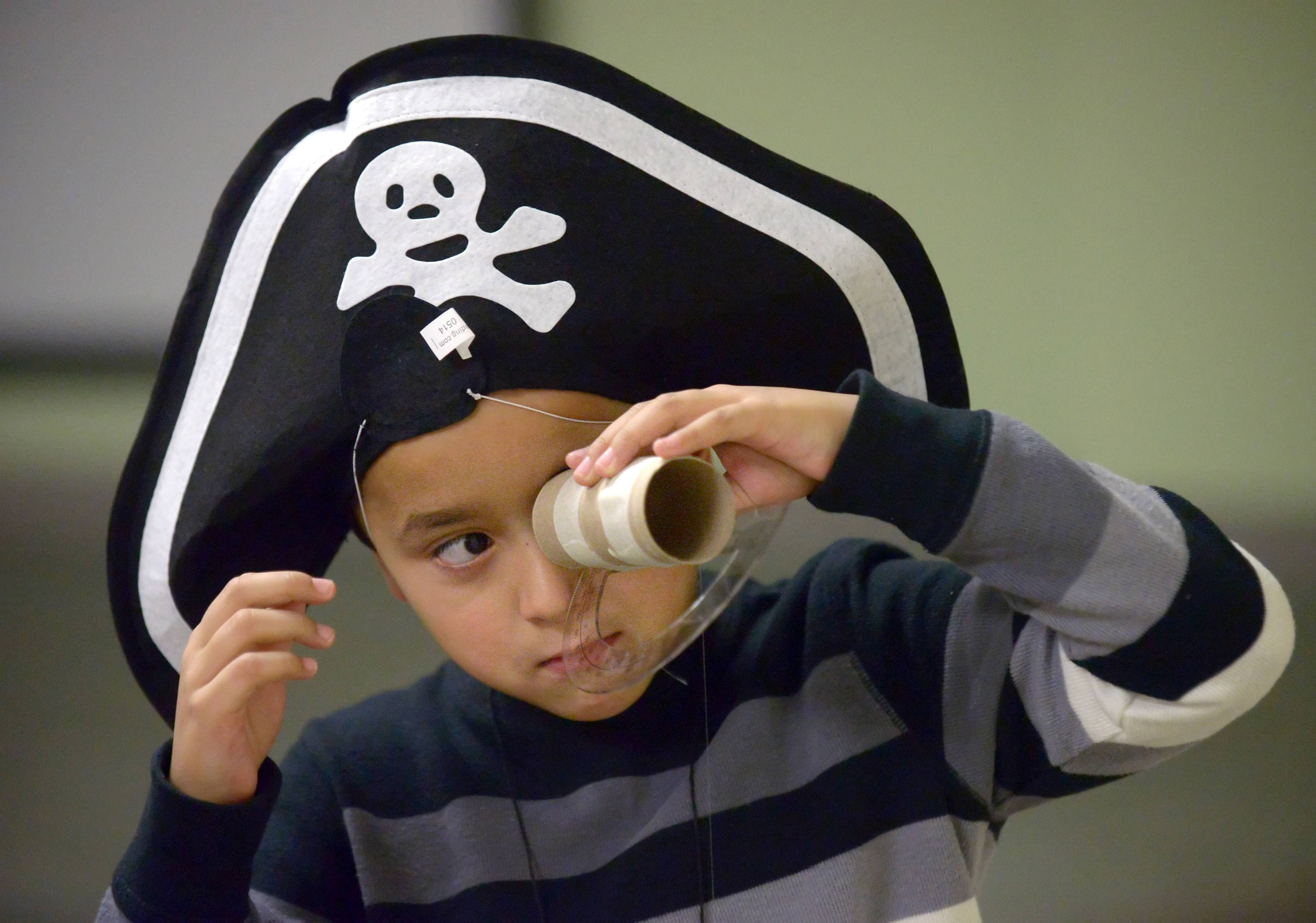 Victor Fernandez, 6, of Carpentersville, scopes for the North Star with his homemade sextant made out of a toilet paper tube, protractor and a weighted string during the Pirate Crew program at the Dundee Library in East Dundee Saturday. Children also drew their own treasure maps, designed a pirate flag, learned pirate lingo, knot tying skills and how to read a chart of the night sky.