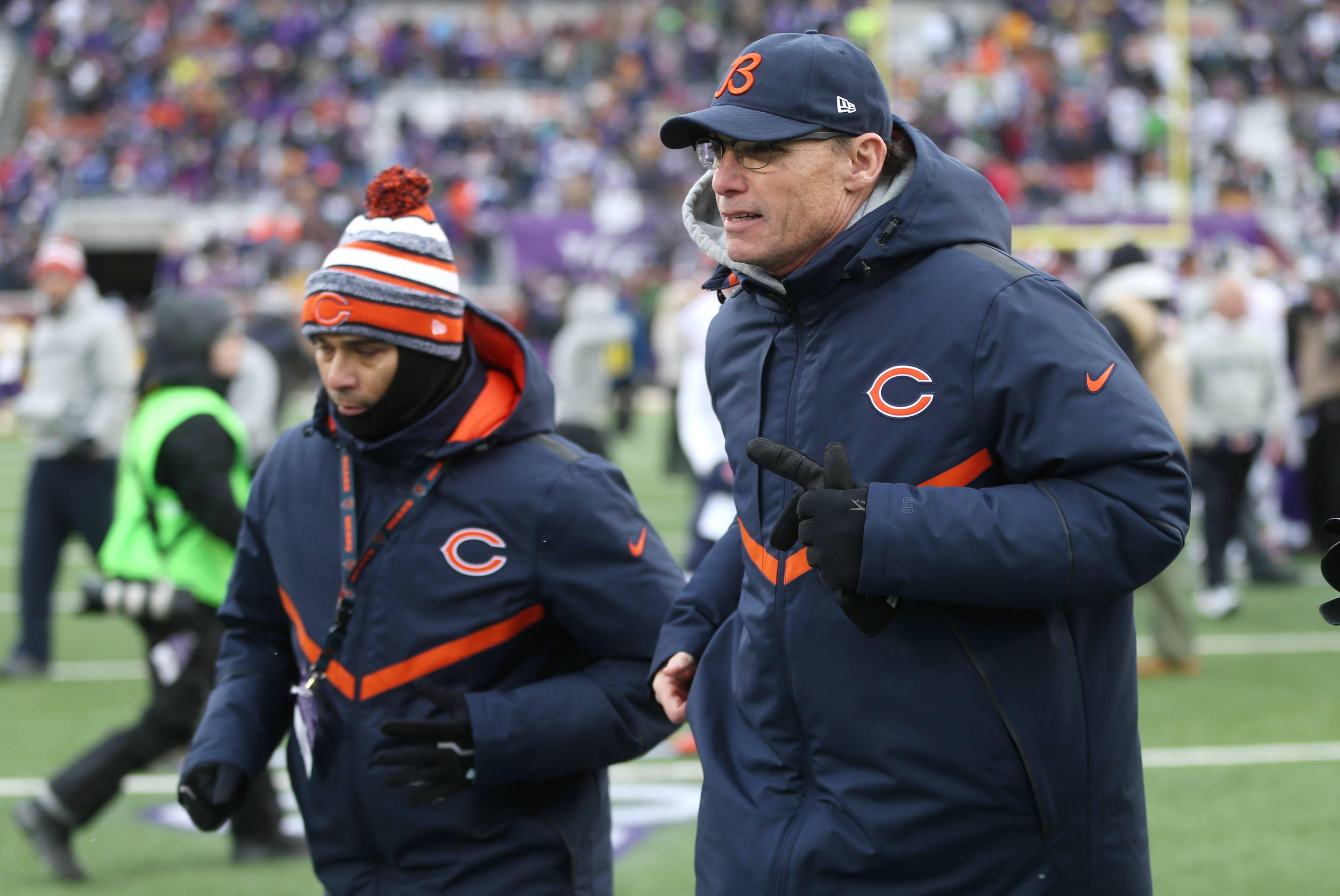 Bears head coach Marc Trestman, right, runs off the field after yesterday's game in Minneapolis. Was it his last as Bears coach?