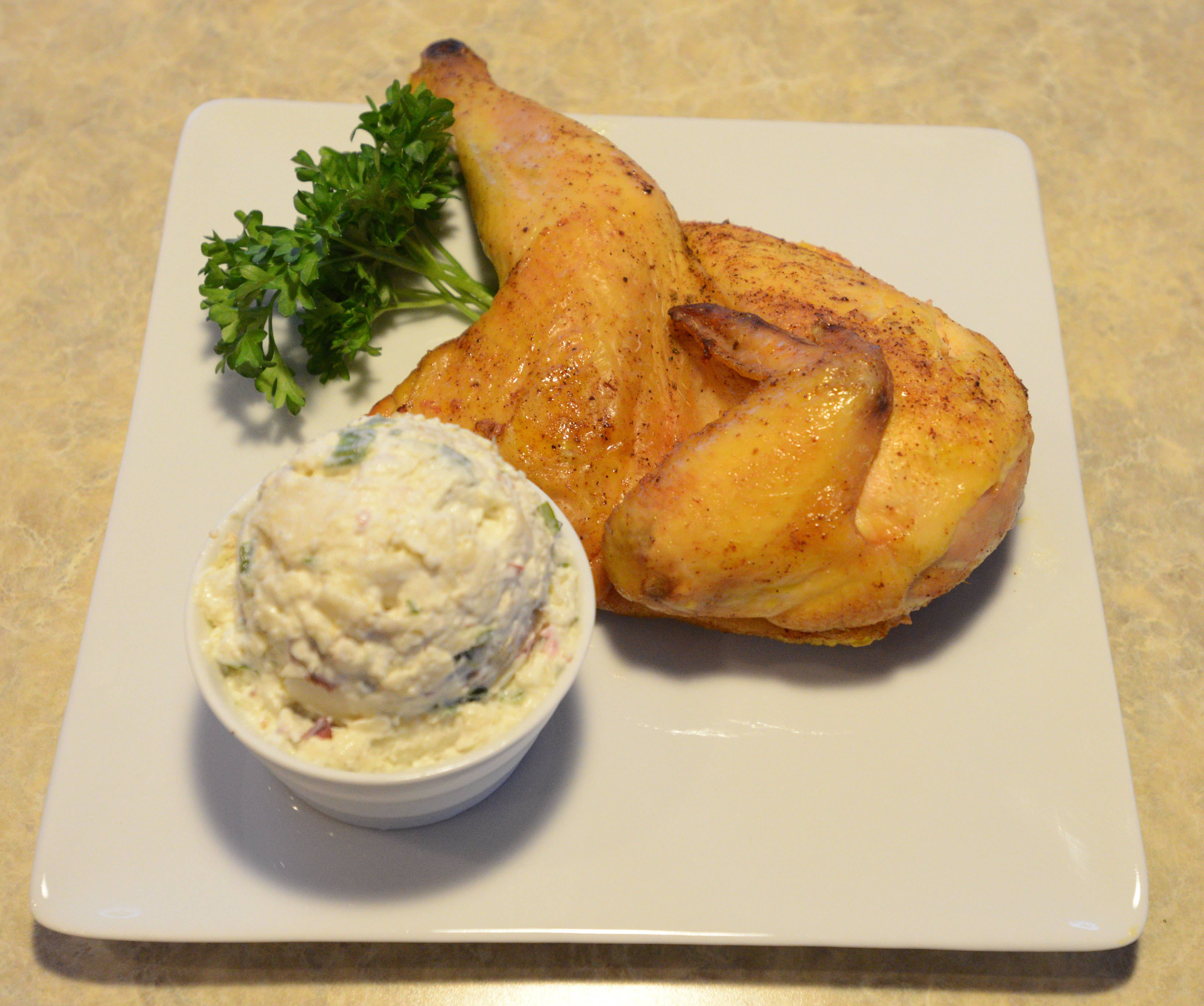 Pair chicken with potato salad or one of 13 other sides at Park West Restaurant & Smokehouse in Villa Park.