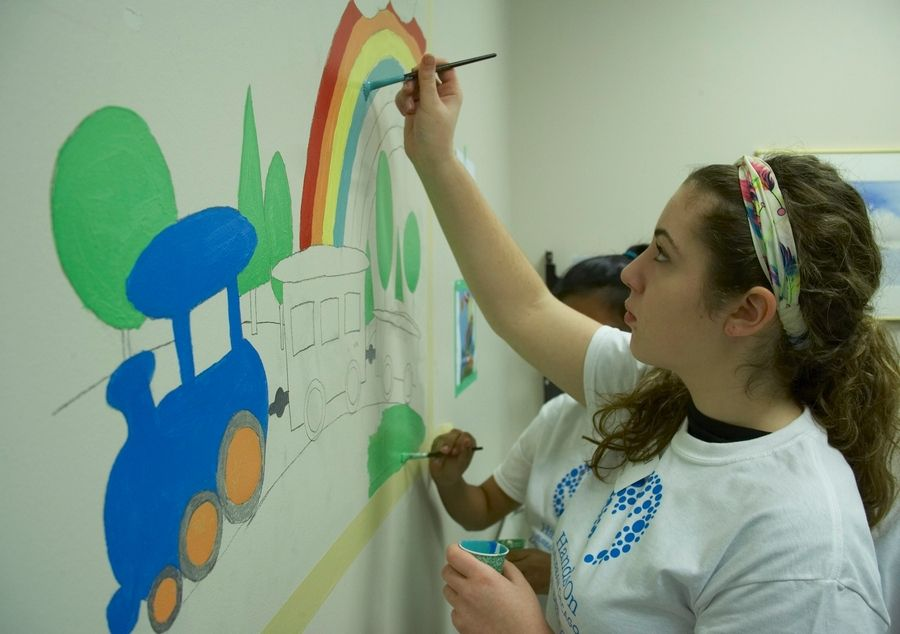 Volunteers paint colorful murals in the examination rooms at the Vista Health Center of Cook County in Palatine as part of a volunteer project with Hands On Suburban Chicago. The Arlington Heights-based nonprofit organization offers nearly 500 different volunteering opportunities across the suburbs, for all age groups and interests.