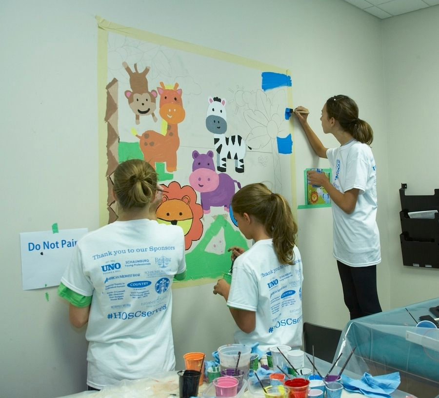 Volunteers paint colorful murals in the examination rooms at the Vista Health Center of Cook County in Palatine during a project with Hands On Suburban Chicago. The Arlington Heights-based nonprofit organization offers nearly 500 different volunteering opportunities across the suburbs, for all age groups and interests.
