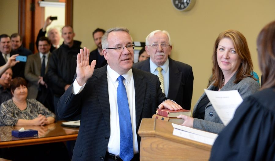 Recently elected state Rep. Steve Andersson is sworn in at the old Kane County Courthouse in Geneva Friday. He was sworn in by Kane County Associate Judge Linda Abrahamson, a law school classmate at Northern Illinois University, while his wife, Nanette, held the bible. Outgoing legislator Tim Schmitz stepped down so Andersson could be in office for next week's special session in Springfield.