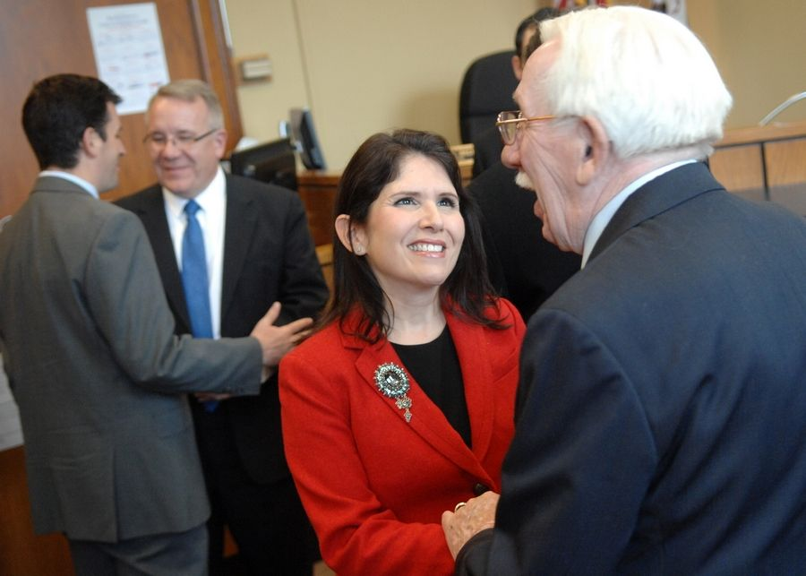 Lt. Gov.-elect Evelyn Sanguinetti talks with Ralph Andersson after his son, state Rep. Steve Andersson, was sworn in Friday at the Kane County Courthouse in Geneva.
