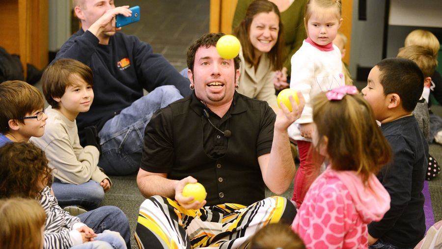 Juggler Jason Kollum shows kids of all ages and their parents his skills Saturday at Messenger Public Library in North Aurora.