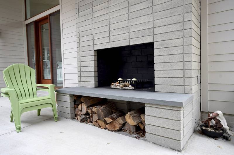 Acorn deck 39 s kit homes blend indoors and outdoors for Fireplace on raised deck