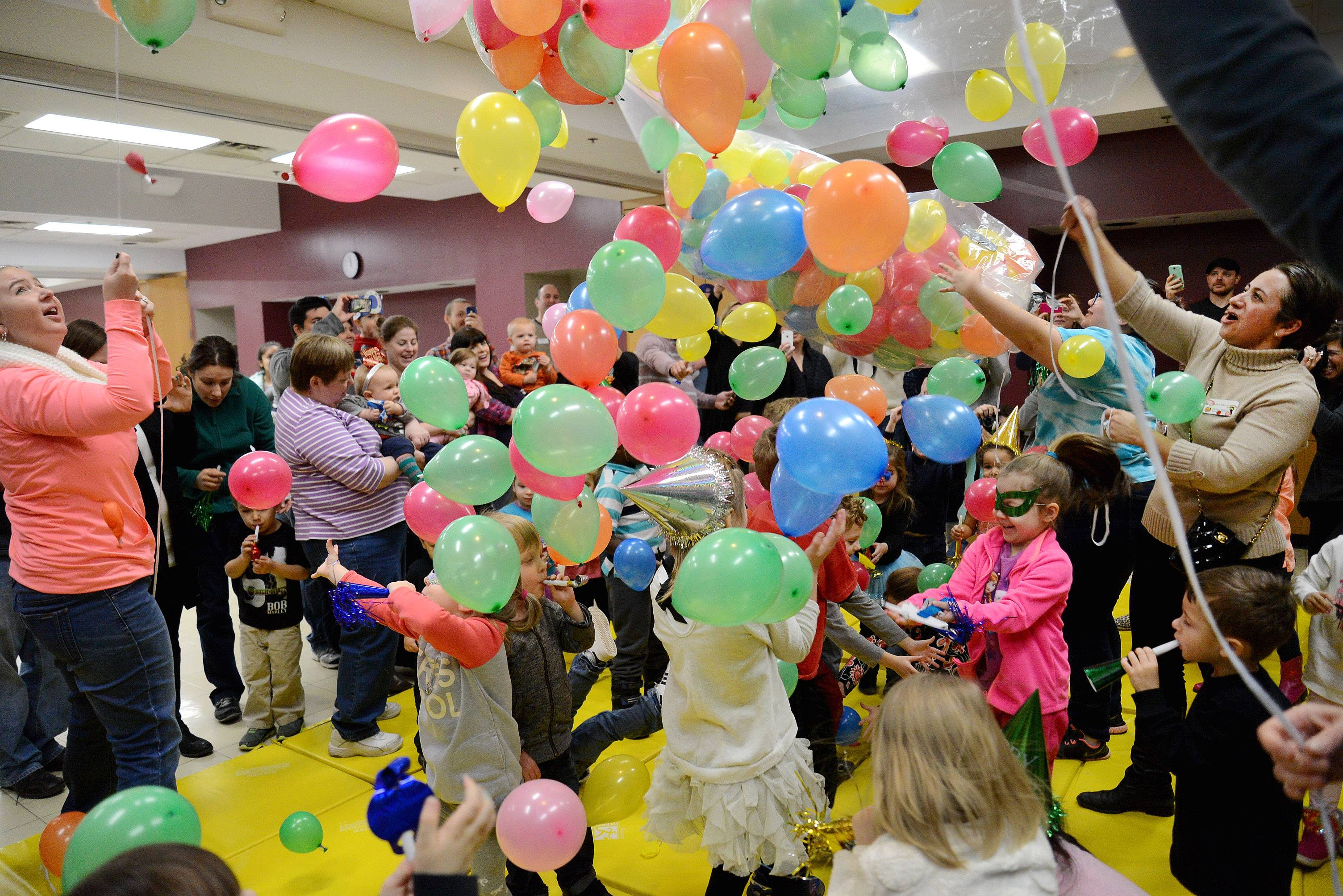 Des Plaines Park District staff release 400 balloons at noon during the second annual Preschool Noon Year's Eve Party at the Prairie Lakes Community Center in Des Plaines.
