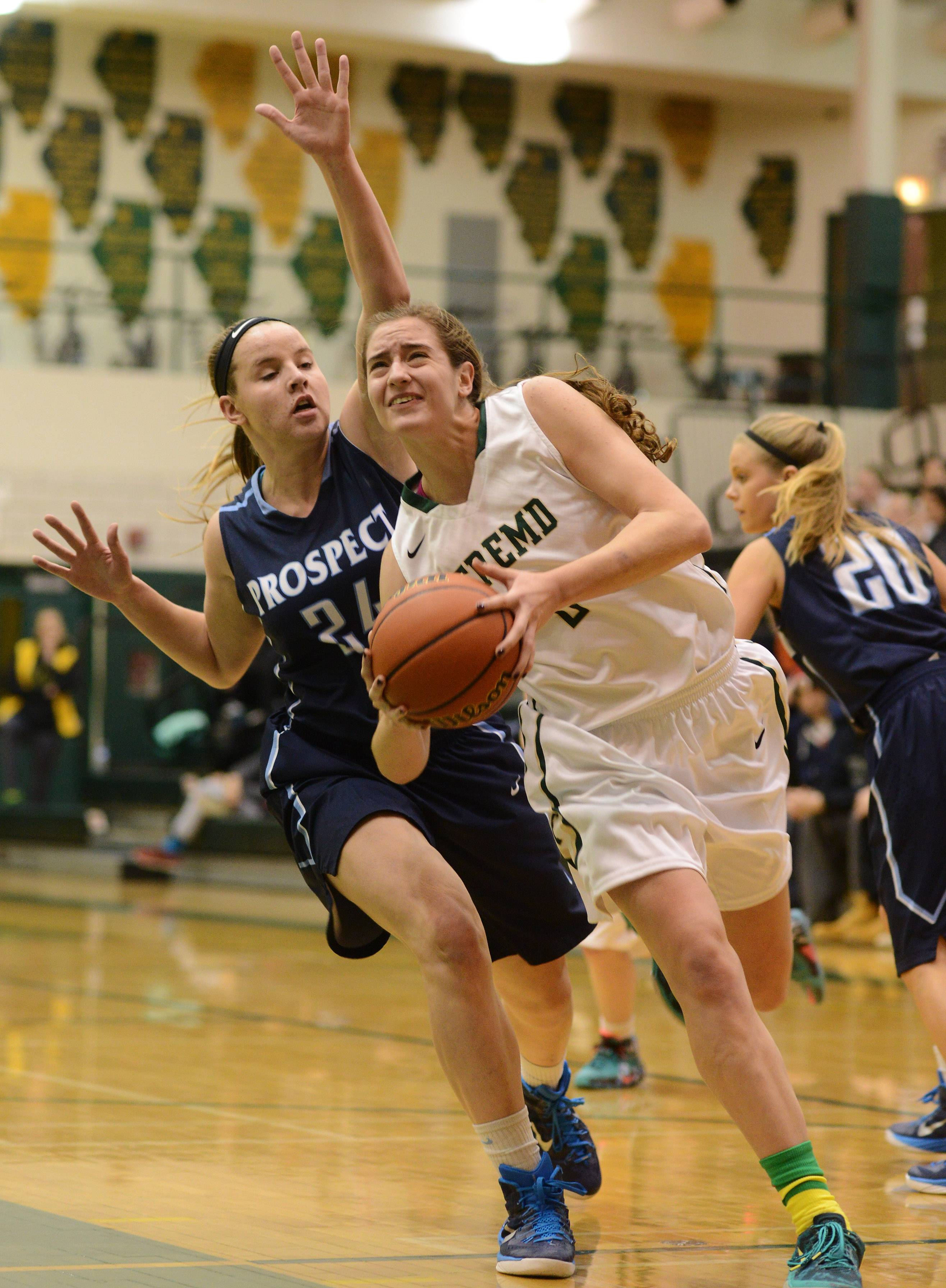 Fremd's Haley Gorecki drives to the basket while being pursued by Prospect's Catherine Sherwood.