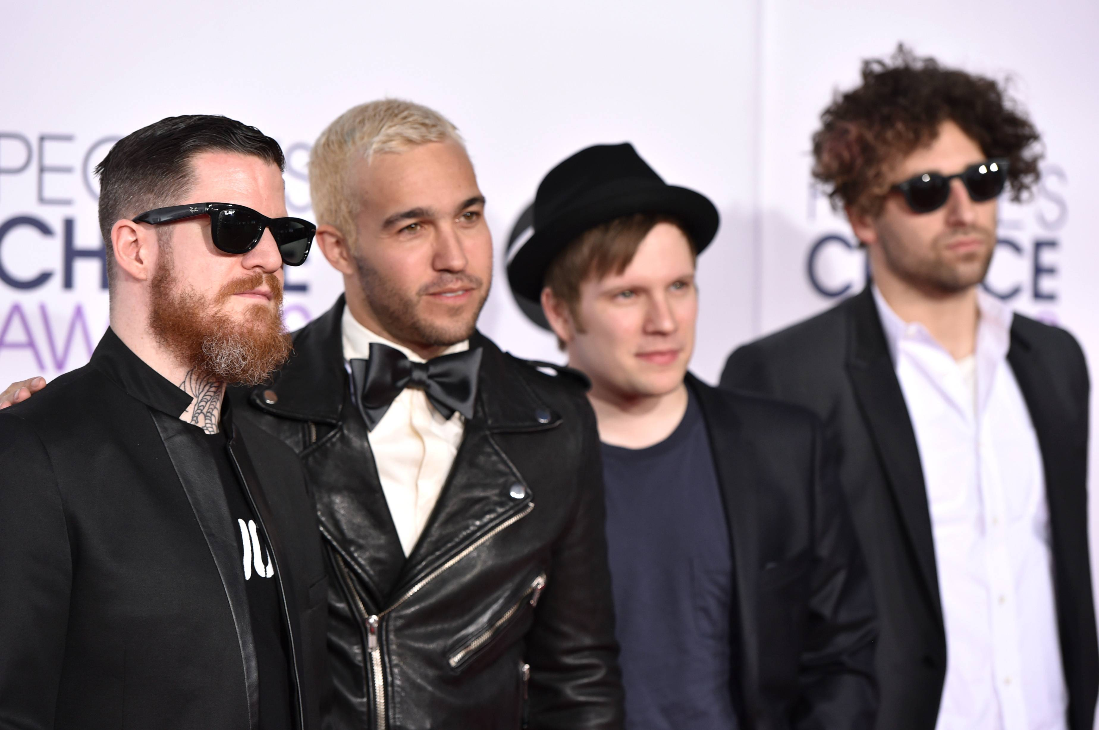 Andy Hurley, from left, Peter Wentz, Patrick Stump, and Joe Trohman of Fall Out Boy arrive at the People's Choice Awards at the Nokia Theatre on Wednesday, Jan. 7, 2015, in Los Angeles.