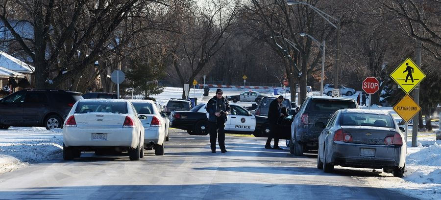 Rosemont police respond to the intersection of Scott Street and Granville Avenue early Wednesday afternoon after an off-duty officer shot and killed his sister's husband in an apparent domestic incident.
