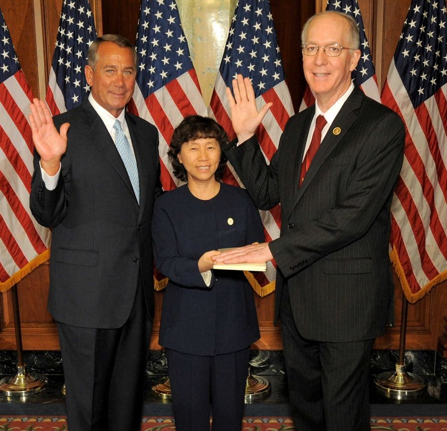 U.S. Rep. Bill Foster of Naperville, pictured with wife Aesook Byon and House Speaker John Boehner, was sworn in for a third term in Congress Tuesday.