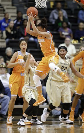 Tennessee guard Andraya Carter (14) grabs a rebound over Vanderbilt guard Jasmine Jenkins, second from left, in the second half of an NCAA college basketball game Monday, Jan. 5, 2015, in Nashville, Tenn. Tennessee won 57-49.