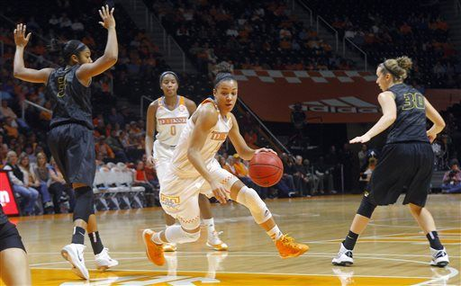 Tennessee guard Andraya Carter (14) drives between Missouri guards Bree Fowler (3) and Morgan Eye (30) during the first half of an NCAA college basketball game Friday, Jan. 2, 2015, in Knoxville, Tenn. Tennessee won 63-53.