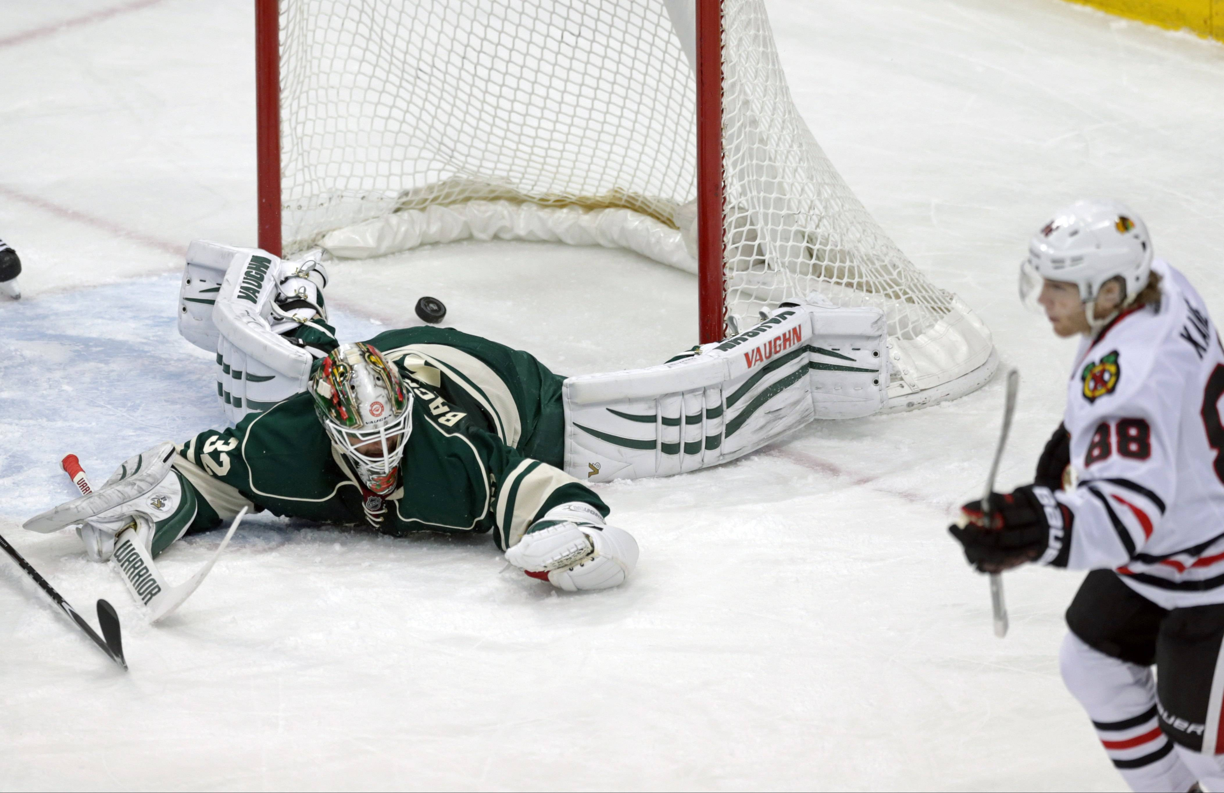 Minnesota Wild goalie Niklas Backstrom, left gives up a power-play goal to Blackhawks' Patrick Kane, right, in the first period of an NHL hockey game on Thursday. The goal was Kane's 20th of the season.
