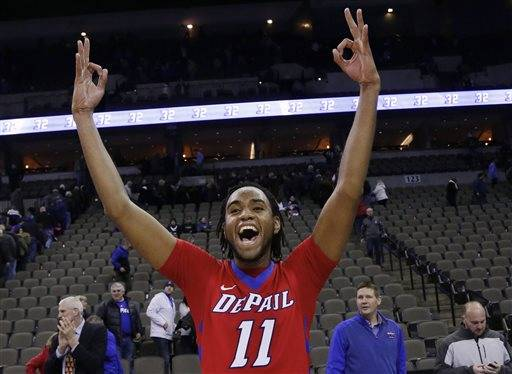 DePaul's Forrest Robinson (11) celebrates his team's 70-60 win over Creighton in an NCAA college basketball game in Omaha, Neb., Wednesday, Jan. 7, 2015. (AP Photo/Nati Harnik)