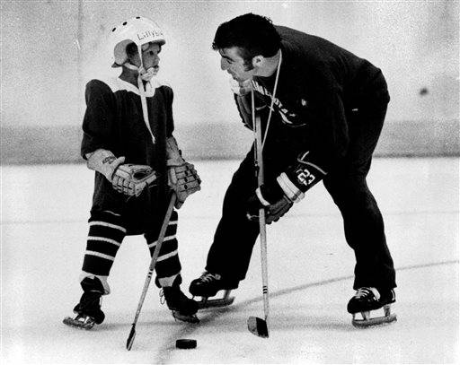 In this June 24, 1971, photo, J.P. Parise gives advise to five-year-old Mike Lillyblad at the Minnesota North Stars hockey clinic in Bloomington, Minn. Parise has died from lung cancer. He was 73. The Minnesota Wild said Thursday he died Wednesday night, Jan. 7, 2015,  at his home in the Minneapolis suburb of Prior Lake. Son and Wild star Zach Parise informed the team of his father's death. (AP Photo/The Star Tribune, )  MANDATORY CREDIT; ST. PAUL PIONEER PRESS OUT; MAGS OUT; TWIN CITIES LOCAL TELEVISION OUT