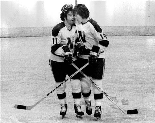 In this Jan. 24, 1973, photo, Minnesota North Stars J.P. Parise (11) and teammate Buster Harvey(18) celebrate a goal by Parise against Los Angeles in Bloomington, Minn. Parise has died from lung cancer. He was 73. The Minnesota Wild said Thursday he died Wednesday night, Jan. 7, 2015,  at his home in the Minneapolis suburb of Prior Lake. Son and Wild star Zach Parise informed the team of his father's death. (AP Photo/The Star Tribune, )  MANDATORY CREDIT; ST. PAUL PIONEER PRESS OUT; MAGS OUT; TWIN CITIES LOCAL TELEVISION OUT