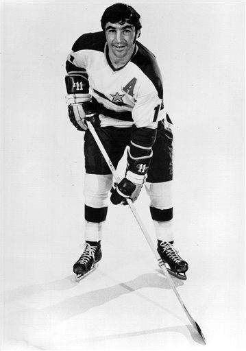 This is an Oct. 19, 1971, photo showing Minnesota Bruins hockey player  J.P. Parise. Parise has died from lung cancer. He was 73. The Minnesota Wild said Thursday he died Wednesday night, Jan. 7, 2015,  at his home in the Minneapolis suburb of Prior Lake. Son and Wild star Zach Parise informed the team of his father's death. (AP Photo/The Star Tribune)  MANDATORY CREDIT; ST. PAUL PIONEER PRESS OUT; MAGS OUT; TWIN CITIES LOCAL TELEVISION OUT