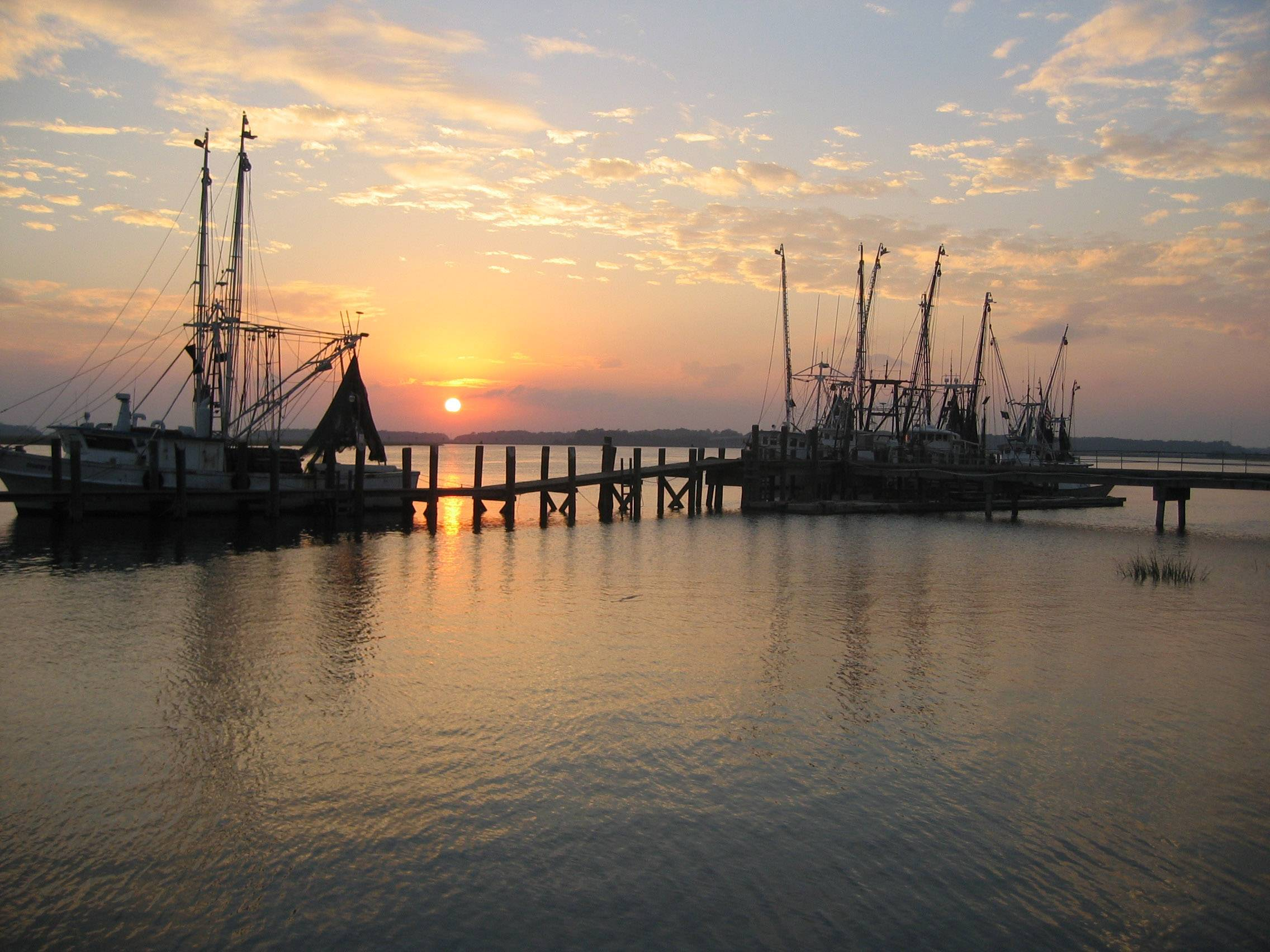 The sun sets around shrimp boats near Beaufort, South Carolina in July 2014