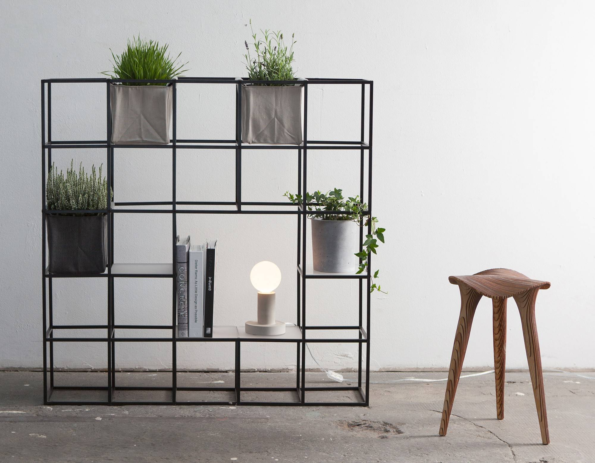 A room divider can add privacy and style to an open floor plan. The Italian-made iPot doubles as a planter and a bookcase.