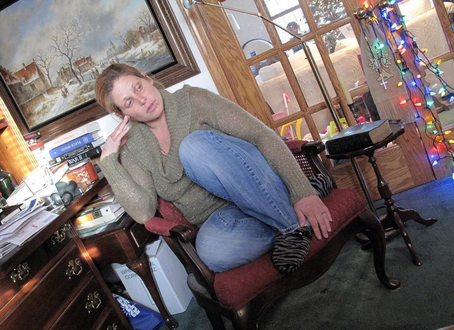 Tracy Perry-Belz, 37, sits in her parents' Schaumburg home the day after Christmas pondering the future of her life and her heroin addiction. Two days later she left home, and her father's car and all the money in the house were gone. By Jan. 6, she was in Cook County jail.