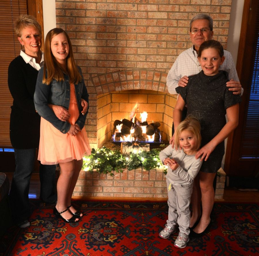 Patty and Kent Perry of Schaumburg take their granddaughters to school, softball, Girl Scouts and religious education, serving as their parents because their mother, 37-year-old Tracy Perry-Belz, is a heroin user.