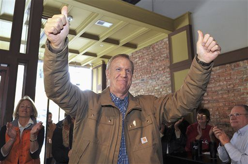 Gov.-elect Bruce Rauner gives thumbs up during a in Moline, Ill., on Saturday, Jan. 10, 2015, to thank supporters ahead of his inauguration Monday, Jan. 12 in Springfield. Rauner was accompanied by Lt. Gov.-elect Evelyn Sanguinetti and Leslie Munger, who is Rauner's choice to fill the comptroller's post left vacant by the unexpected death last month of Judy Baar Topinka.
