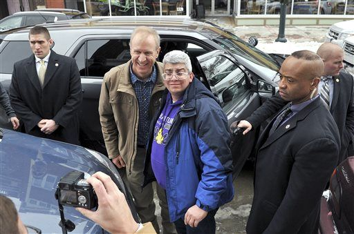 Republican Gov.-elect Bruce Rauner, center left, poses for photos with supporters at a stop in Moline, Ill.,on Saturday, Jan. 10, 2015, during a tour of the state before his inauguration on Monday, Jan. 12 in Springfield.