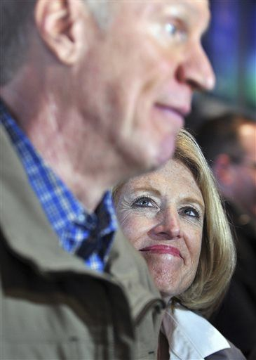 Leslie Munger listens as Gov.-elect Bruce Rauner answers questions in Moline, Ill., on Saturday, Jan. 10, 2015. Munger, a suburban Chicago businesswoman, is Rauner's choice to fill the comptroller's post left vacant by the unexpected death last month of Judy Baar Topinka. Rauner is on a tour of the state to thank supporters ahead of his inauguration Monday, Jan. 12 in Springfield.