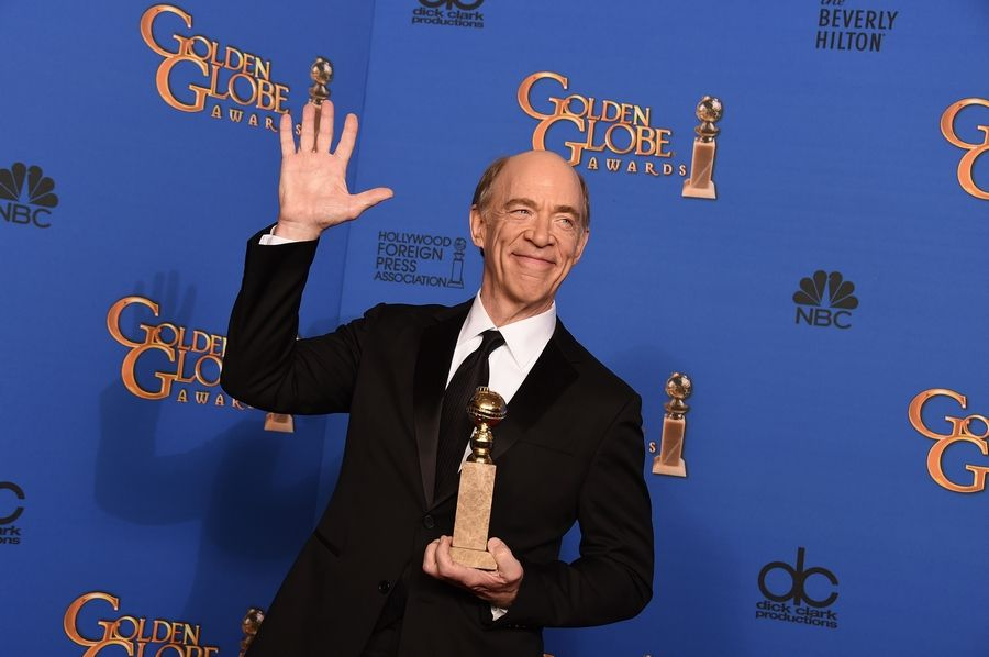 "J.K. Simmons poses in the press room with the award for best supporting actor in a motion picture - drama, musical or comedy for ""Whiplash"" at the 72nd annual Golden Globe Awards."