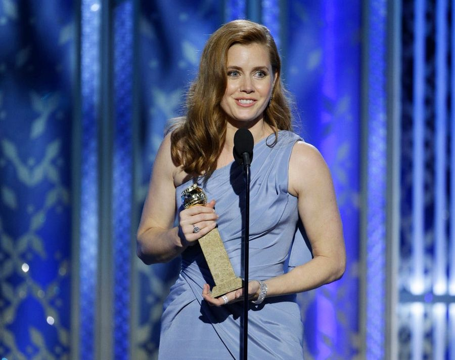 "In this image released by NBC, Amy Adams accepts the award for best actress in a motion picture comedy or musical for her role in ""Big Eyes"" at the 72nd Annual Golden Globe Awards."