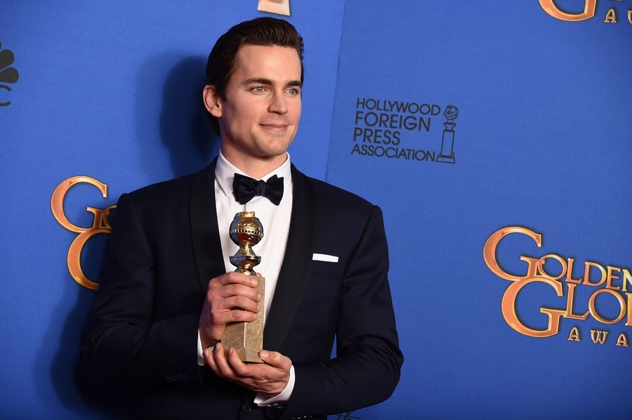 "Matt Bomer poses in the press room with the award for best supporting actor in a series, miniseries or television movie for ""The Normal Heart""at the 72nd annual Golden Globe Awards."