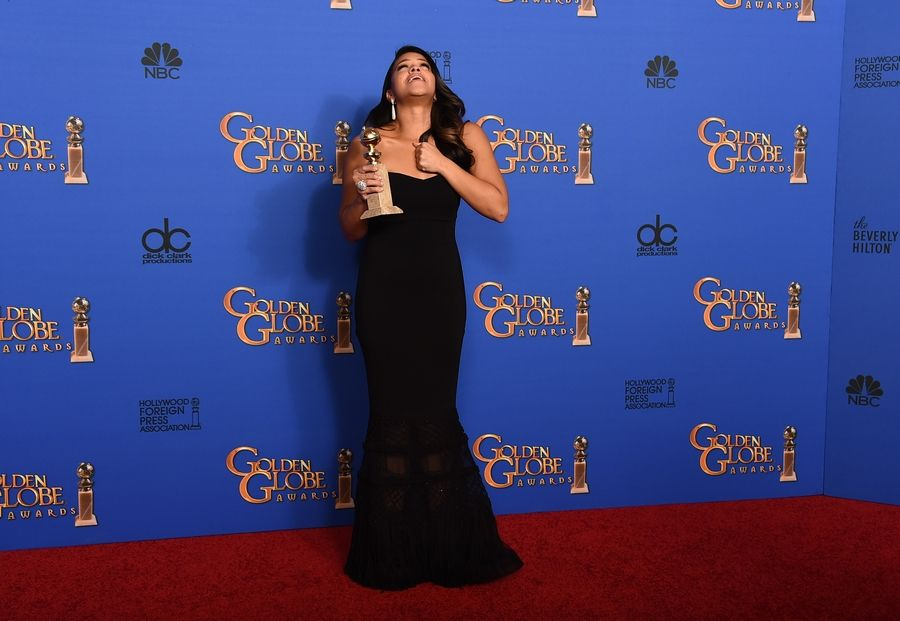 "Gina Rodriguez poses in the press room with the award for best actress in a television series - musical or comedy for ""Jane the Virgin"" at the 72nd annual Golden Globe Awards."