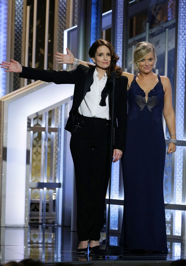 In this image released by NBC, co-hosts Tiny Fey, left, and Amy Poehler introduce Oprah Winfrey at the 72nd Annual Golden Globe Awards on Sunday.