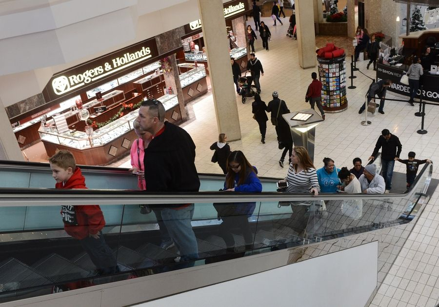 Shoppers ride the escalator on the day after Christmas 2014 at Woodfield Mall. By next holiday season, the interior of the Schaumburg shopping center is expected to look significantly different.