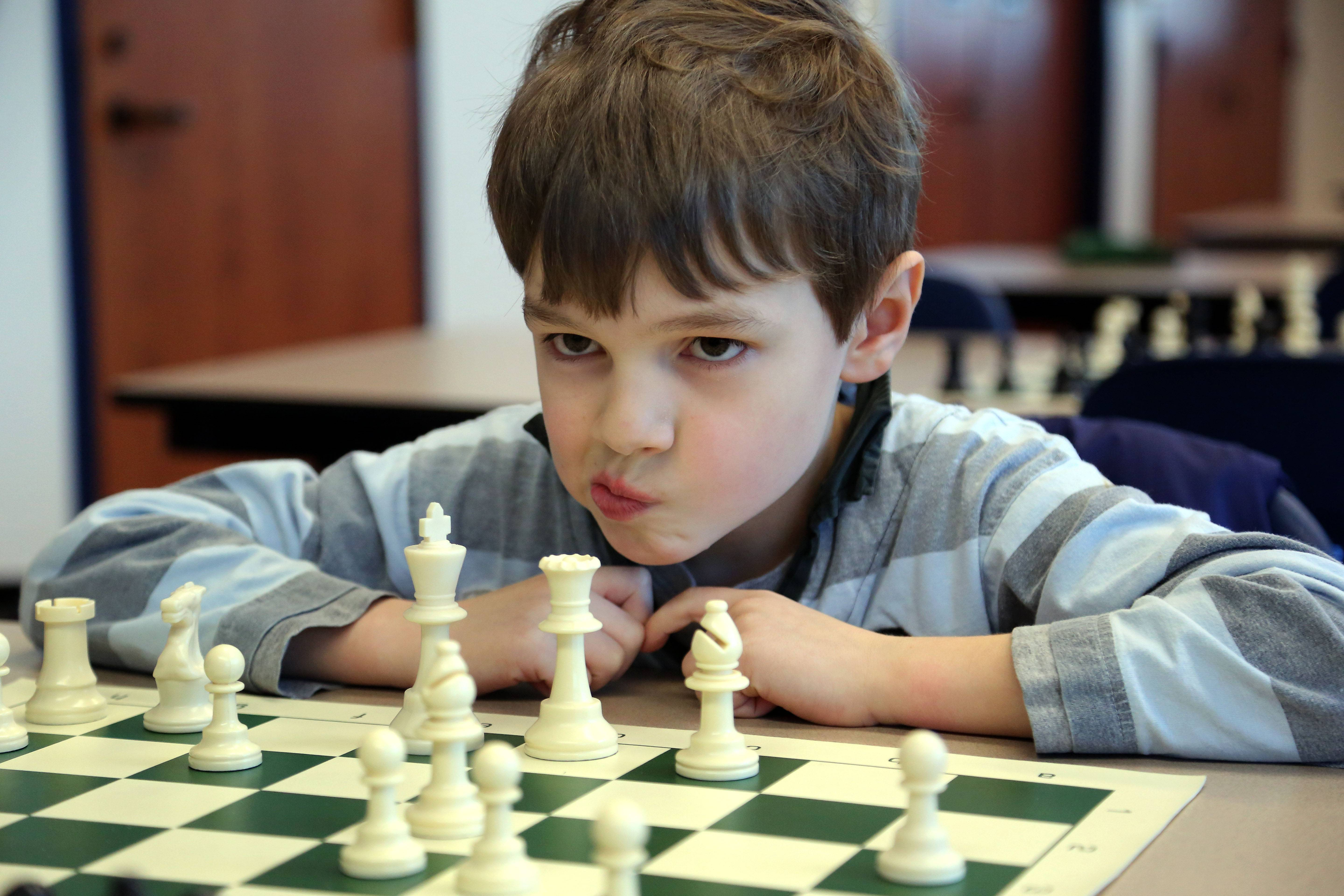 8-year-old Josiah Smith, of Grayslake, ponders his next move during chess club at Grayslake Public Library Friday. Experienced and beginner players ages 8 to 14 were welcome.